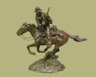 Man on a horse with a gun